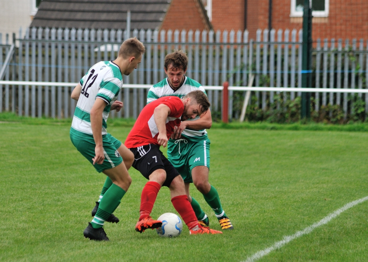 Michael Charlton in the thick of the action during the 3-1 win against West Allotment Celtic
