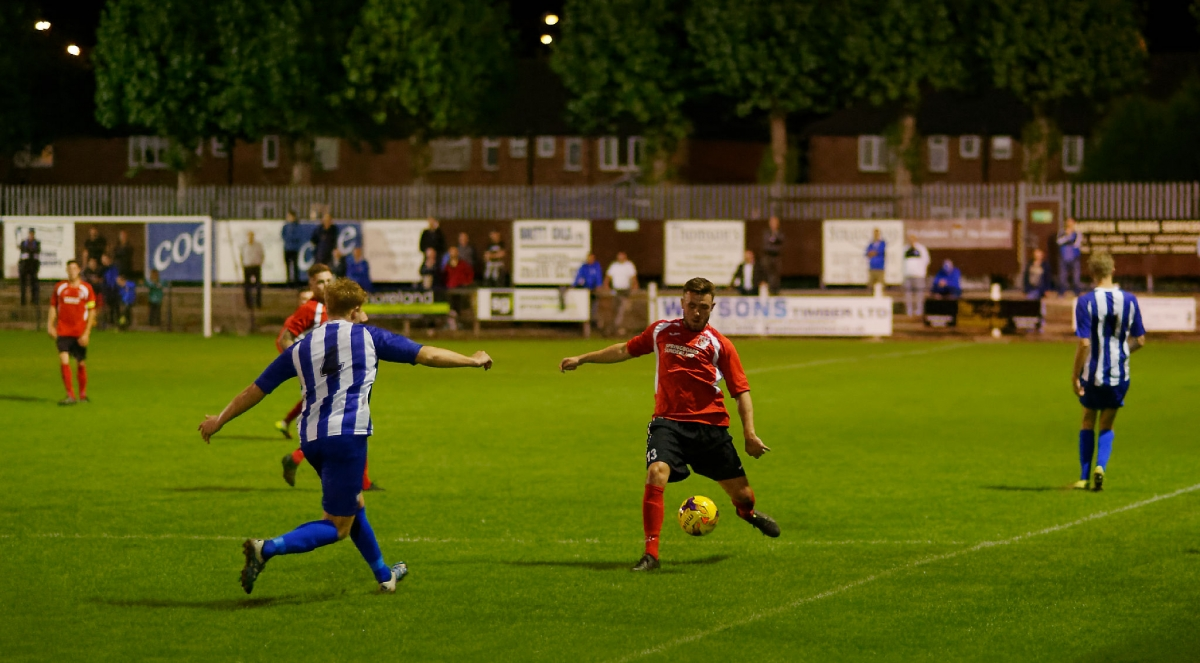Substitute Luke Richardson clearing the ball in the 3 - 2 defeat at Hillheads