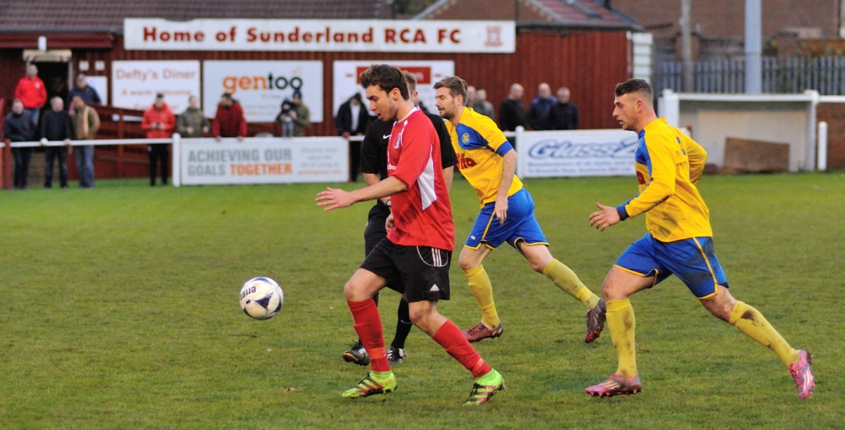 James Armstrong goes past two Stockton defenders and the referee during the vase match at Meadow Park. Photograph by Simon Mears.