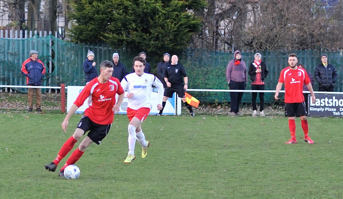 Greg Swansbury comes away with the ball during the first half of the epic 3 -3 encounter with Consett. Photograph by Simon Mears.
