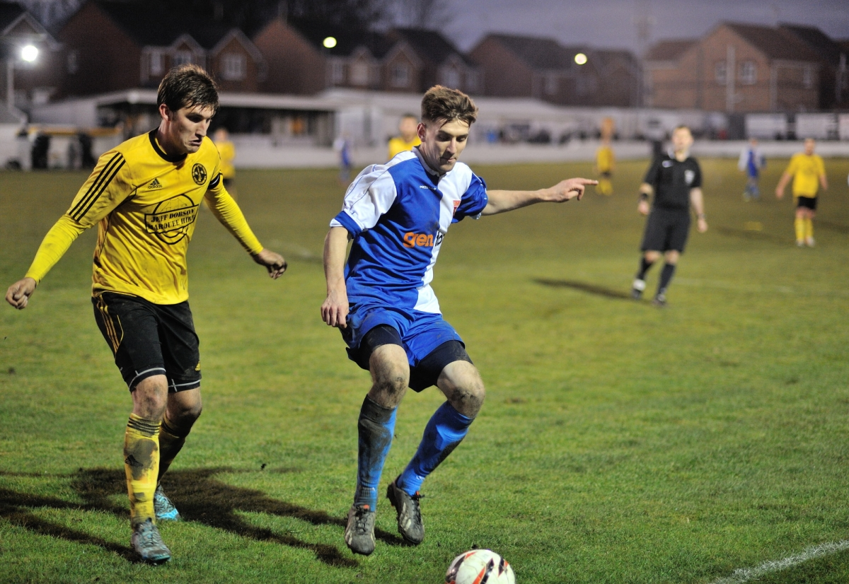 Craig Hodgson shields the ball from West Auckland captain and former RCA player Thomas Marron. Photograph: Simon Mears.